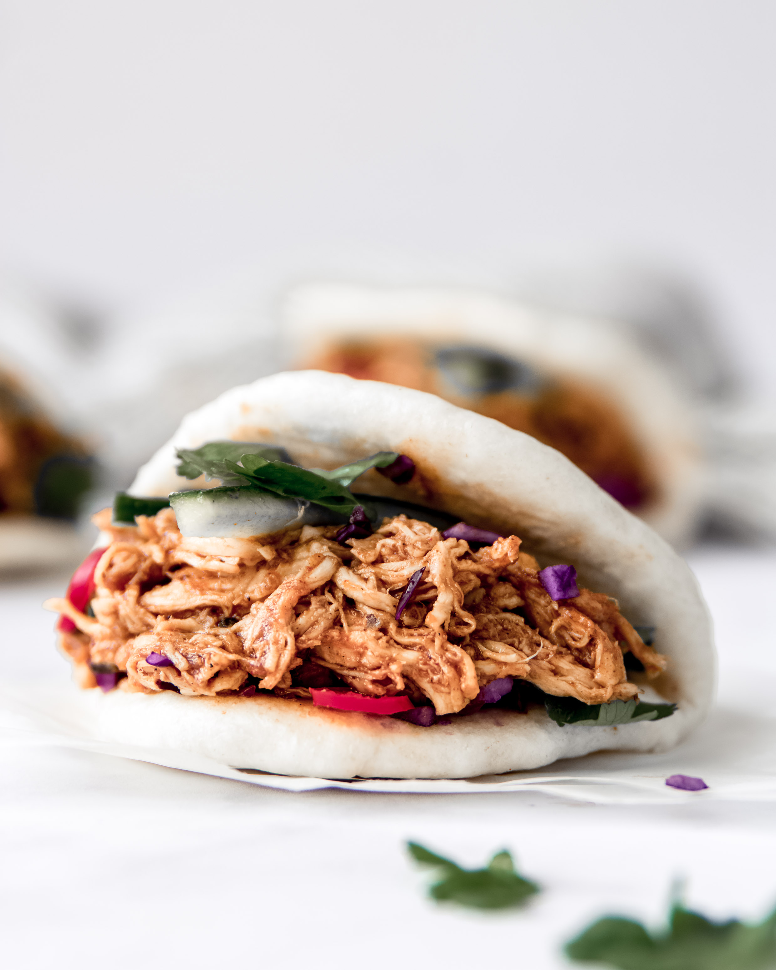 bao buns met pulled chicken